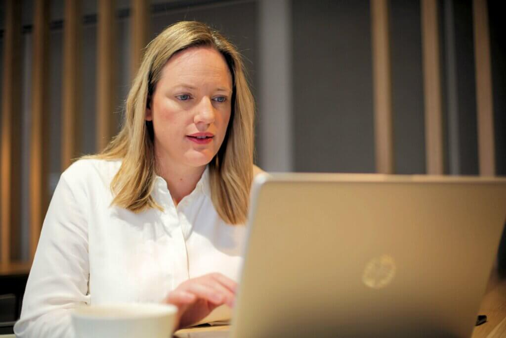 Lisa Mahar Working On Laptop